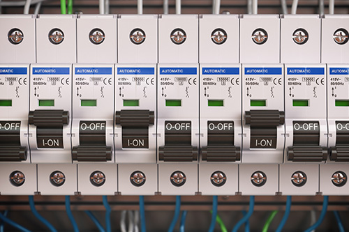 Electric fusebox switches with green and blue wires