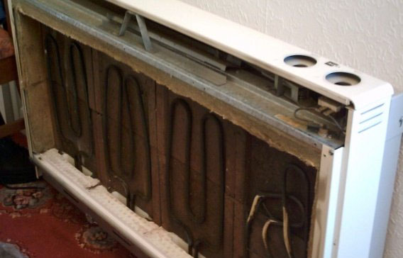 Opened storage heater showing elements
